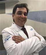 Dr. Gustavo Comodo
