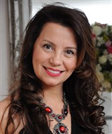 Dra. Cláudia Arantes Santana